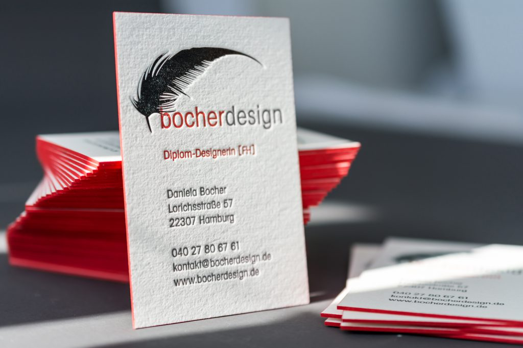 Letterpress business card with hotfoilstamping in silver and red edge painted